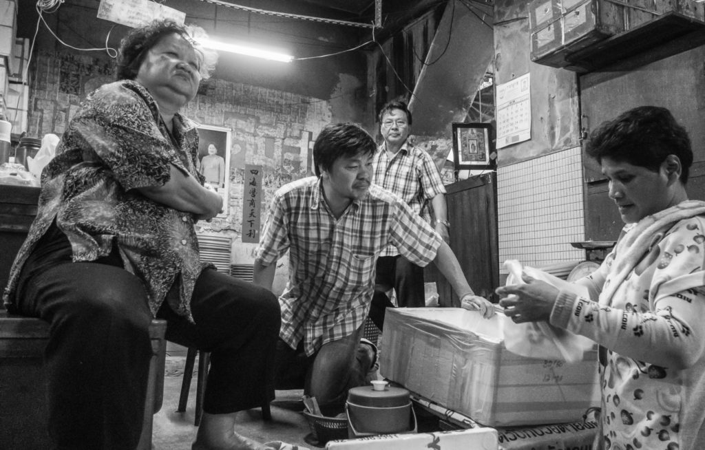 Transaction at Phutharet Market, Bangkok